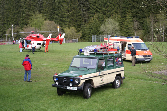 HEMS mission with helicopter, mountain rescue and ambulance