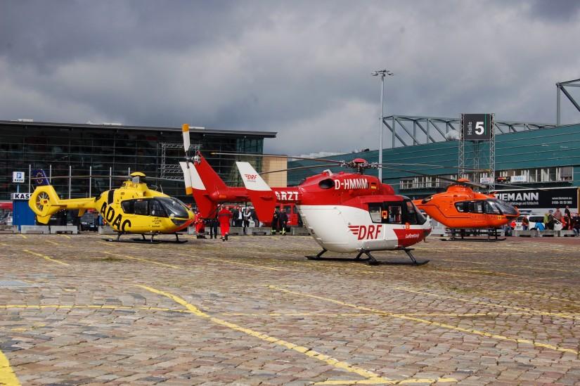 Zum Schluss sieht man noch einmal Helikopter aller drei bisherigen Betreiber einträchtig vereint – Anlass war im Oktober 2012 die Fachmesse AKUT